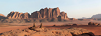 Massive mountain with towering cliffs emerging from wide sandy valleys to reach heights of 1700 meters and more, Wadi Rum Protected Area (WRPA), Wadi Rum National Park, also known as The Valley of the Moon, 74,000-hectare, UNESCO World Heritage Site, desert landscape, southern Jordan, Middle East. Picture by Manuel Cohen