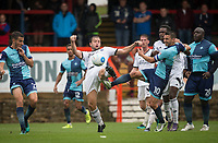 Matt Bloomfield of Wycombe Wanderers & Jake Gallagher of Aldershot Town go for the ball during the pre season friendly match between Aldershot Town and Wycombe Wanderers at the EBB Stadium, Aldershot, England on 22 July 2017. Photo by Andy Rowland.
