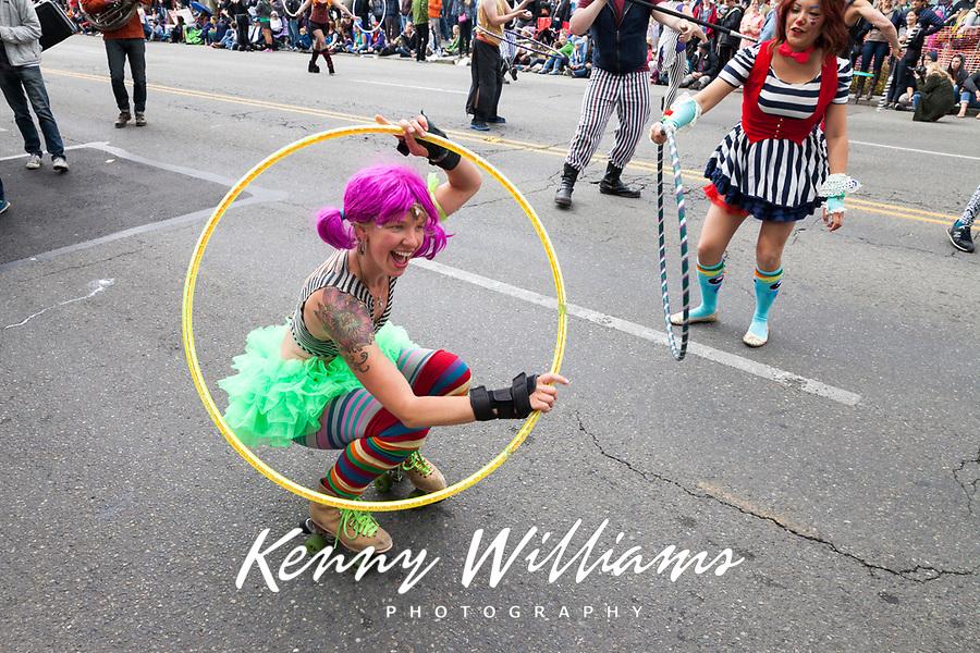 Hula hoop artist and street performer, Fremont Solstice Parade & Festival, Seattle, Washington, USA.