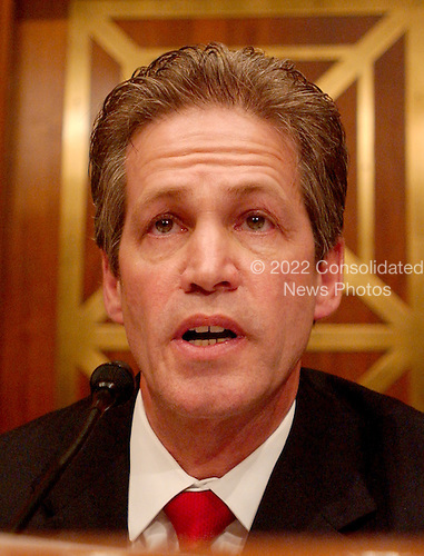"""Washington, D.C. - May 17, 2005 -- United States Senator Norm Coleman (Republican of Minnesota), Chairman, United States Senate Committee on Homeland Security and Governmental Affairs Permanent Subcommittee on Investigations questions George Galloway , Member of Parliament for Bethnal Green and Bow, Great Britain, during the hearing on """"Oil For Influence: How Saddam Used Oil to Reward Politicians Under the United Nations Oil-for-Food Program"""" in Washington, D.C. on May 17, 2005.  .Credit: Ron Sachs / CNP"""