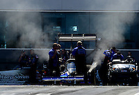 Apr. 13, 2012; Concord, NC, USA: NHRA top fuel dragster driver Pat Dakin prepares to do his burnout during qualifying for the Four Wide Nationals at zMax Dragway. Mandatory Credit: Mark J. Rebilas-
