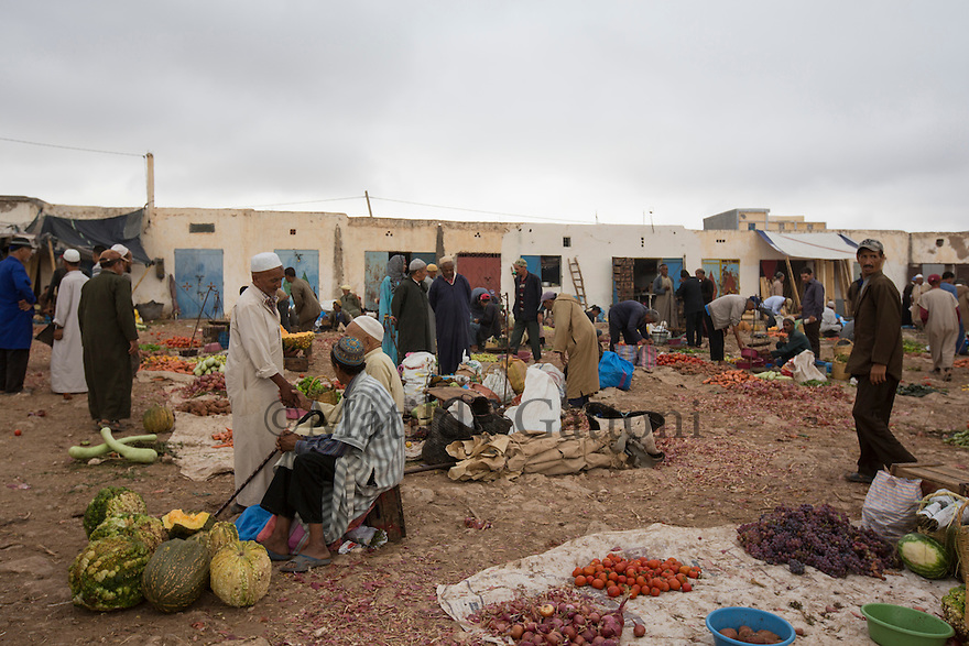 Morocco - Tidzi - The market of Tidzi where part of the Argan fruits and oil are sold. <br /> The popularity and profitabilty of the argan oil has also attracted the attention of profiteers. Some of the argan found in the big Moroccan cities is cut with sunflower oil, whose colour is very similar. Moreover, in order to profit from state subventions, many ordinary shops and businesses have disguised themselves as cooperatives, employing few women as window-dressing.