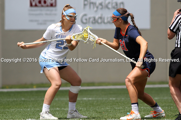 01 May 2016: North Carolina's Molly Hendrick (23) and Syracuse's Kayla Treanor (21) challenge for a draw. The University of North Carolina Tar Heels played the Syracuse University Orange at Lane Stadium in Blacksburg, Virginia in the 2016 Atlantic Coast Conference Women's Lacrosse Tournament championship match. North Carolina won 15-14 in overtime.