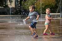 NWA Democrat-Gazette/BEN GOFF @NWABENGOFF<br /> Desmond Ward (left), 2, of Rogers and Isabella Primm, 1, of Bella Vista play in the splash pad Wednesday, Sept. 4, 2019, at Lawrence Plaza in downtown Bentonville. Bentonville Parks and Recreation plans to hold a public input meeting for the downtown parks master plan 6:00 p.m. Monday, Sept. 16 at the Bentonville Public Library.