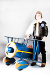 Retro child pilot with antique pedal plane