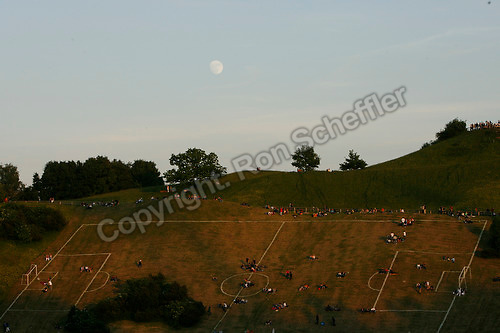 Jun 9, 2006; Munich, GERMANY; Soccer fans rest on the side of a hill transformed into a soccer field in Olympiapark, the 1972 Munich Olympics complex, on the opening day of the World Cup. Germany plays Costa Rica in Munich and Poland plays Ecuador in Gelsenkirchen in Group A first round action. Mandatory Credit: Ron Scheffler-US PRESSWIRE Copyright © Ron Scheffler