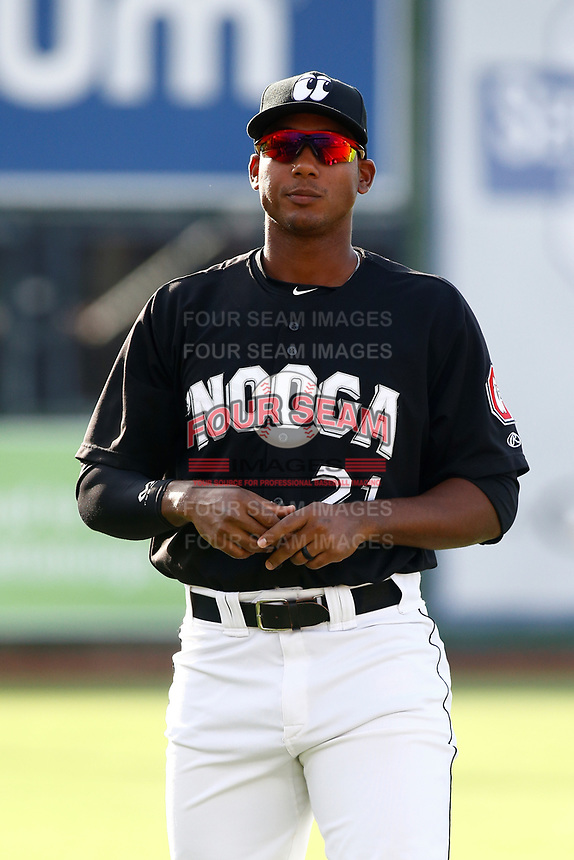 Edgar Corcino (21) of the Chattanooga Lookouts stands on the field prior to the game against the Montgomery Biscuits on May 26, 2018 at AT&T Field in Chattanooga, Tennessee. (Andy Mitchell/Four Seam Images)