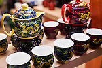 Chinese tea sets, painted decorative teapots and cups on display at a store in Shanghai, China