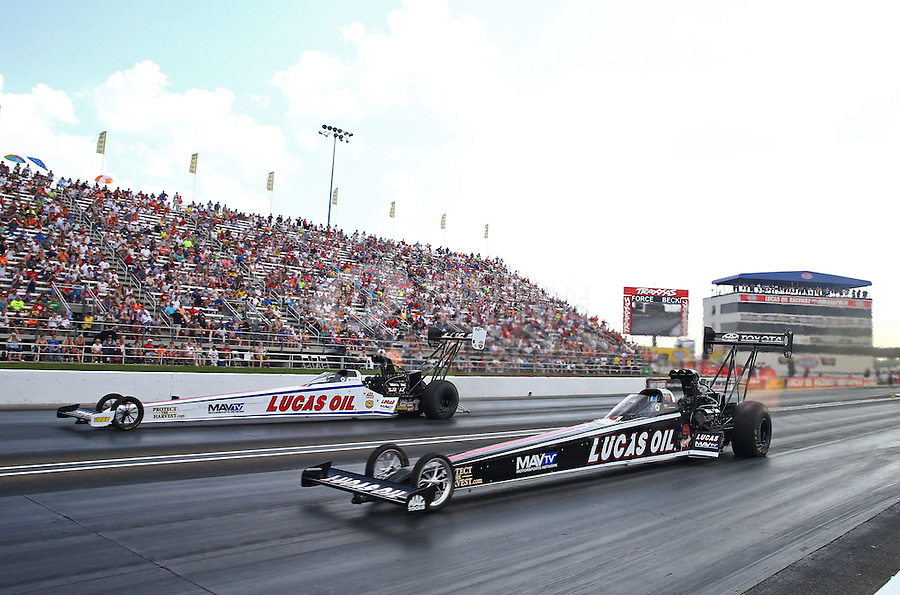 Sep 7, 2015; Clermont, IN, USA; NHRA top fuel driver Morgan Lucas (near) defeats teammate Richie Crampton during the US Nationals at Lucas Oil Raceway. Mandatory Credit: Mark J. Rebilas-USA TODAY Sports