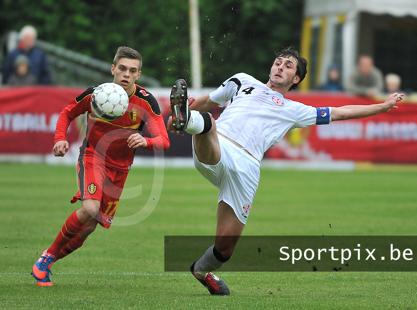 Georgia U19 - Belgium U19 : Nika Sandokhadze (4) on the ball before Leandro Trossard (17)<br /> foto DAVID CATRY / Nikonpro.be