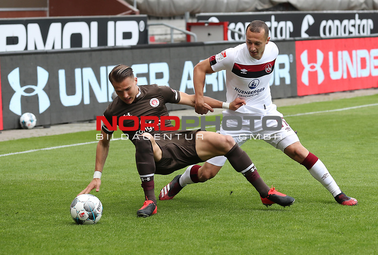 nph00001  17.05.2020 --- Fussball --- Saison 2019 2020 --- 2. Fussball - Bundesliga --- 26. Spieltag: FC Sankt Pauli - 1. FC Nürnberg ---  DFL regulations prohibit any use of photographs as image sequences and/or quasi-video - Only for editorial use ! --- <br /> <br /> Leo Östigard Oestigard (3, FC St. Pauli ) Adam Zrelak (11, 1. FC Nürnberg ) <br /> <br /> Foto: Daniel Marr/Zink/Pool//via Kokenge/nordphoto