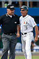 May 31, 2009:  NCAA Division 1 Gainesville Regional:    First Base umpire John Ausmus tries to keep Miami head coach Jim Morris (3) separated from home plate umpire David Wiley after a disputed call over a batter hit by a pitch duringregional action at Alfred A. McKethan Stadium on the campus of University of Florida in Gainesville.  Morris was later ejected. The Florida Gators defeated the Miami Hurricanes 16-5 and will advance to the Super Regionals in Gainesville............
