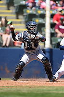 Mobile BayBears catcher Raywilly Gomez (15) throws down to second during a game against the Huntsville Stars on April 23, 2014 at Joe Davis Stadium in Huntsville, Tennessee.  Huntsville defeated Mobile 4-1.  (Mike Janes/Four Seam Images)