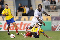 Mario Yepes (3) of Colombia (COL) tackles the ball from Eddie Johnson (9) of the United States (USA). The men's national teams of the United States (USA) and Colombia (COL) played to a 0-0 tie during an international friendly at PPL Park in Chester, PA, on October 12, 2010.