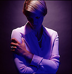 Dramatically lit blond woman with face in shadow