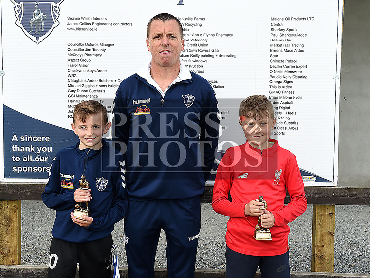Ardee Celtic's U-11 players of the year Cole Leavy and Conor Clinton with coach Sean Leavy. Photo:Colin Bell/pressphotos.ie