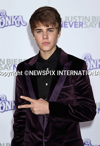"""JUSTIN BIEBER.at his """"Never Say Never"""" World Premiere, Nokia Theatre, Los Angeles_08/02/2011.Mandatory Photo Credit: ©M.Philips_Newspix International..**ALL FEES PAYABLE TO: """"NEWSPIX INTERNATIONAL""""**..PHOTO CREDIT MANDATORY!!: NEWSPIX INTERNATIONAL(Failure to credit will incur a surcharge of 100% of reproduction fees)..IMMEDIATE CONFIRMATION OF USAGE REQUIRED:.Newspix International, 31 Chinnery Hill, Bishop's Stortford, ENGLAND CM23 3PS.Tel:+441279 324672  ; Fax: +441279656877.Mobile:  0777568 1153.e-mail: info@newspixinternational.co.uk"""