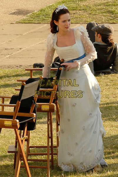 "EMILY BLUNT .On the film set of ""Gulliver's Travels"" in Greenwich, South East London, England, UK, June 1st 2009..filmset movie on location filming full length long white costume period dress chairs sheer sleeves blue sash tiara hairband .CAP/IA.©Ian Allis/Capital Pictures"
