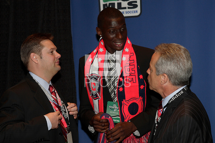 Chicago Fire first round draft pick Bakary Soumare talks with President and CEO John Guppy, and Head Coach Dave Sarachan during the first round of the MLS SuperDraft at the Indiana Convention Center, Indianapolis, IA, on Jan 12, 2007.