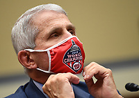 Dr. Anthony Fauci, director of the National Institute for Allergy and Infectious Diseases, prepares to testify before a House Subcommittee on the Coronavirus Crisis hearing on a national plan to contain the COVID-19 pandemic, on Capitol Hill in Washington, DC on Friday, July 31, 2020.  <br /> Credit: Kevin Dietsch / Pool via CNP /MediaPunch