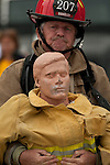 Vancouver, Canada, Aug 6th 2009.  World Police and Fire Games, Ultimate Firefighter  Competition.  Competitor Daniel W.  Broadley of the Mesa Fire Department, Arizona, USA, strains to drag the dummy around the obstacle course.  Photo by Gus Curtis
