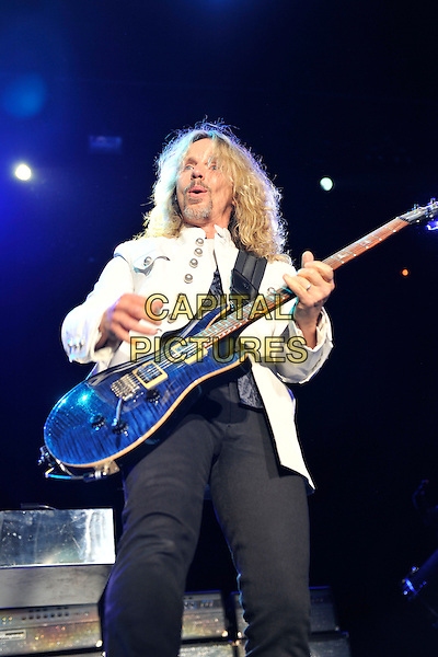 Styx - Tommy Shaw.Styx performing live at Wembley Arena, London, England..June 4th, 2011.stage concert live gig performance music half length black  suit guitar white jeans denim.CAP/MAR.© Martin Harris/Capital Pictures.