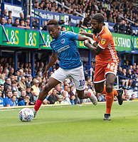 Portsmouth's Jamal Lowe (left) under pressure from Shrewsbury Town's Anthony Grant (right) <br /> <br /> Photographer David Horton/CameraSport<br /> <br /> The EFL Sky Bet League One - Portsmouth v Shrewsbury Town - Saturday September 8th 2018 - Fratton Park - Portsmouth<br /> <br /> World Copyright &copy; 2018 CameraSport. All rights reserved. 43 Linden Ave. Countesthorpe. Leicester. England. LE8 5PG - Tel: +44 (0) 116 277 4147 - admin@camerasport.com - www.camerasport.com
