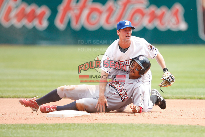 May 28, 2009:  Second Baseman Jonathan Malo of the Buffalo Bisons attempts to turn a double play as Jason Ellison of the Lehigh Valley Ironipgs slides in to break it up during a game at Coca-Cola Field in Buffalo, NY.  The Bisons are the International League Triple-A affiliate of the New York Mets.  Photo by:  Mike Janes/Four Seam Images
