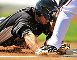 8 March 2011: New York Yankees' outfielder Brett Gardner is caught stealing third during a Spring Training game against the Atlanta Braves at Champion Park in Orlando, Florida. The Yankees edged out the Braves 5-4 in Grapefruit League action. Mandatory Credit: Ed Wolfstein Photo