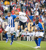 Ricardo Clark heads the ball over Honduras' Wilson Palacios, left, World Cup Qualifying match at Soldier Field, in Chicago, IL, Saturday, June 6, 2009. The USA won 2-1 over Honduras.