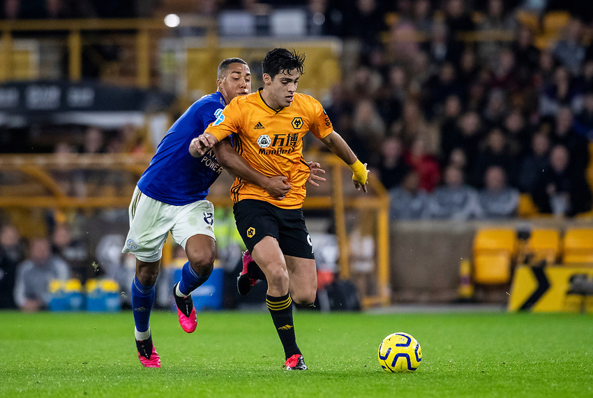 Leicester City's Youri Tielemans (left) pulls back Wolverhampton Wanderers' Raul Jimenez <br /> <br /> Photographer Andrew Kearns/CameraSport<br /> <br /> The Premier League - Wolverhampton Wanderers v Leicester City - Friday 14th February 2020 - Molineux - Wolverhampton<br /> <br /> World Copyright © 2020 CameraSport. All rights reserved. 43 Linden Ave. Countesthorpe. Leicester. England. LE8 5PG - Tel: +44 (0) 116 277 4147 - admin@camerasport.com - www.camerasport.com