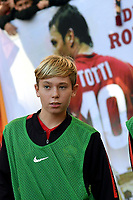 Cristian Totti, ball boy, son of former AS Roma player Francesco Totti, looks on in front of a banner with the picture of his father before the Serie A 2018/2019 football match between AS Roma and UC Sampdoria at stadio Olimpico, Roma, November, 11, 2018 <br />  Foto Andrea Staccioli / Insidefoto
