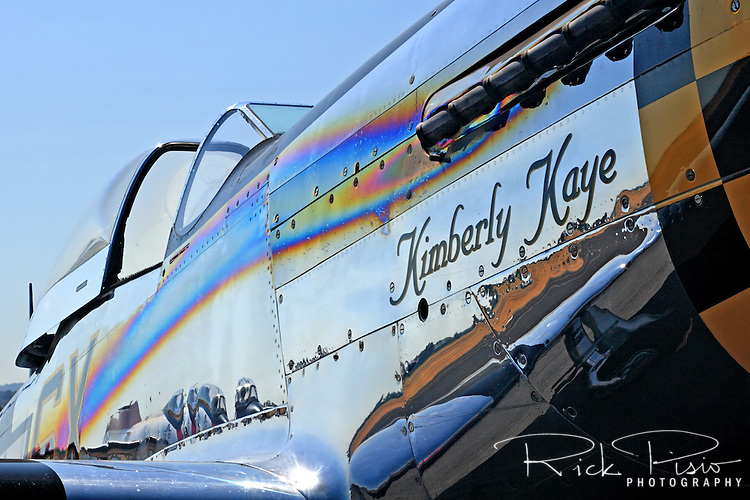 "Heat streaming from the exhaust stacks has discolored the fuselage of the highly polished P-51D Mustang ""Kimberly Kaye."" The P-51 Mustang is considered to be the premier fighter of the World War II and many are kept in flying condition by their civilian owners."