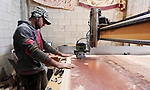 """A Palestinian man works on a CNC machine as he manufactures traditional lanterns known in Arabic as """"Fanous"""" on the holy month of Ramadan in Gaza city, on May 9, 2019. Ramadan is sacred to Muslims because it is during that month that tradition says the Koran was revealed to the Prophet Mohammed. The fast is one of the five main religious obligations under Islam. Muslims around the world will mark the month, during which believers abstain from eating, drinking, smoking and having sex from dawn until sunset. Photo by Mahmoud Ajjour"""