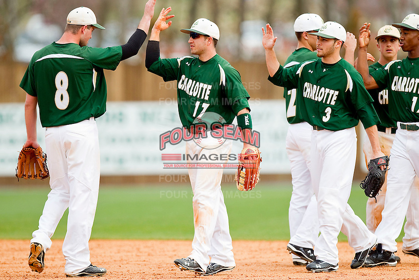The Charlotte 49ers celebrate their 10-0 win over the Saint Peter's Peacocks in game one of a double header at Robert and Mariam Hayes Stadium on February 18, 2012 in Charlotte, North Carolina.  Brian Westerholt / Four Seam Images