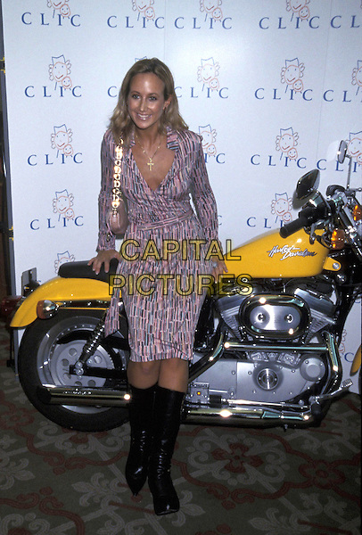 LADY VICTORIA HERVEY .22 October 2001.full length printed pink purple wrap dress yellow motorbike bike motorcycle.ref:11159.www.capitalpictures.com.sales@capitalpictures.com.©Capital Pictures