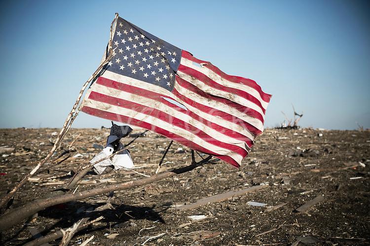 American flag in debris after tornado