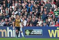 Two Swansea City supporters show Alexis Sanchez of Arsenal how to take a throw in after he took a foul throw during the Barclays Premier League match between Swansea City and Arsenal played at The Liberty Stadium, Swansea on October 31st 2015