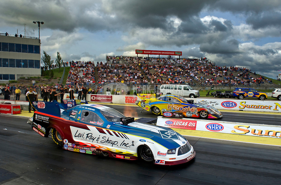 May 20, 2011; Topeka, KS, USA: NHRA funny car driver Tim Wilkerson (near) races alongside Jim Head during qualifying for the Summer Nationals at Heartland Park Topeka. Mandatory Credit: Mark J. Rebilas-