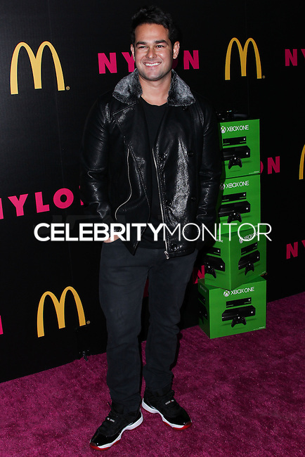 WEST HOLLYWOOD, CA - DECEMBER 05: Adrian Vera arriving at the Nylon Magazine December 2013/January 2014 Cover Launch Party held at Quixote Studios on December 5, 2013 in West Hollywood, California. (Photo by Xavier Collin/Celebrity Monitor)