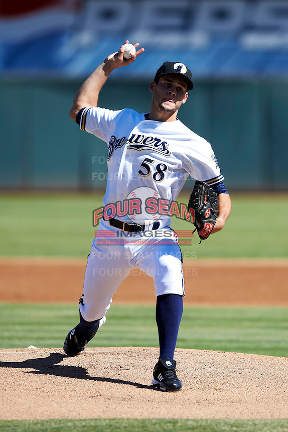 Phoenix Desert Dogs pitcher Nick Bucci #58, of the Milwaukee Brewers organization, during an Arizona Fall League game against the Mesa Solar Sox at Phoenix Municipal Stadium on October 19, 2012 in Phoenix, Arizona.  Phoenix defeated Mesa 10-6.  (Mike Janes/Four Seam Images)