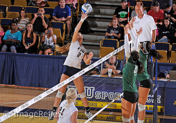 Florida International University women's volleyball outside hitter Lucia Castro (2) plays against the University of Alabama Birmingham. FIU won the match 3-0 on October 11, 2013 at Miami, Florida.