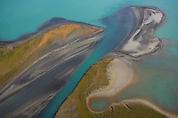 Aerial view over Lake Laitaure showing silt deposits from Rapa river forming sand spits and vegetational growth, Sarek National Park, Sweden.
