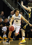 Gonzaga's Kevin Pangos (4) is guarded by Iowa's Adam Woodbury (32) during the 2015 NCAA Division I Men's Basketball Championship's March 22, 2015 at the Key Arena in Seattle, Washington. #2 Gonzaga beat #7 Iowa 87-68 to advance to the Sweet 16. ©2015. Jim Bryant Photo. ALL RIGHTS RESERVED.