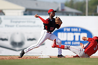 Batavia Muckdogs second baseman Demetrius Sims (55) throws to first base as Jake Scheiner (3) slides in during the second game of a doubleheader against the Williamsport Crosscutters on August 20, 2017 at Dwyer Stadium in Batavia, New York.  Batavia defeated Williamsport 4-3.  (Mike Janes/Four Seam Images)