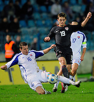 Robbie Rogers (19) battles against Jan Durica (16). Slovakia defeated the US Men's National Team 1-0 at the Tehelne Pole in Bratislava, Slovakia on November 14th, 2009.