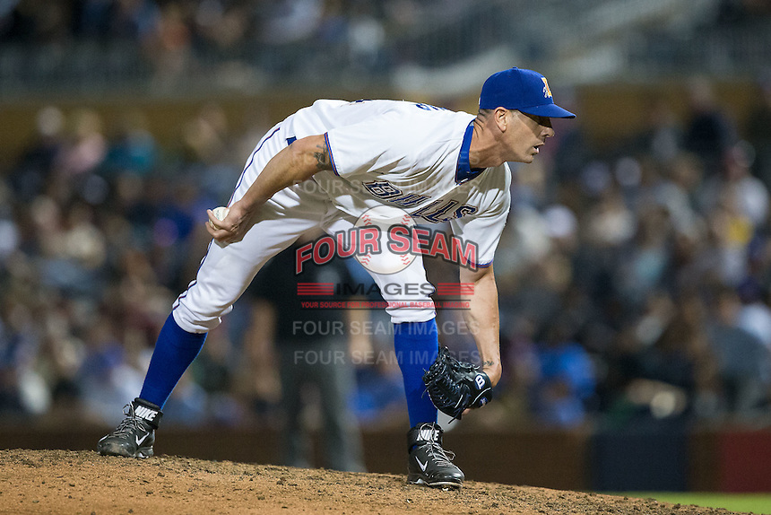 Durham Bulls relief pitcher Grant Balfour (34) looks to his catcher for the sign against the Scranton/Wilkes-Barre RailRiders at Durham Bulls Athletic Park on May 15, 2015 in Durham, North Carolina.  The RailRiders defeated the Bulls 8-4 in 11 innings.  (Brian Westerholt/Four Seam Images)