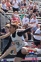 Jefferson City High School track and field hurdles coach Kirk Obermiller (red shirt) watches as Jefferson City senior Leslie Farmer clears the final hurdle of the Girls 300-meter hurdles, just after a Francis Howell Noth runner at the Missouri Class 4 Sectional 3 Track and Field championship meet, in Camdenton, MO. Saturday, May 17, 2008.