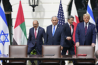 "From left to right: Dr. Abdullatif bin Rashid Alzayani, Minister of Foreign Affairs, Kingdom of Bahrain; Prime Minister Benjamin Netanyhu of Israel; Sheikh Abdullah bin Zayed bin Sultan Al Nahyan, Minister of Foreign Affairs and International Cooperation of the United Arab Emirates; and United States President Donald J. Trump walk to the table during a signing ceremony of the ""Abraham Accords"" on the South Lawn of the White House in Washington, DC on Tuesday, September 15, 2020.   <br /> Credit: Chris Kleponis / Pool via CNP /MediaPunch"
