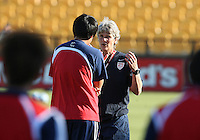 Pia Sundhage coach of the USA WNT talks to Xiaopeng Li coach of the PRC WNT during an international friendly match at KSU Soccer Stadium, on October 2 2010 in Kennesaw, Georgia. USA won 2-1.